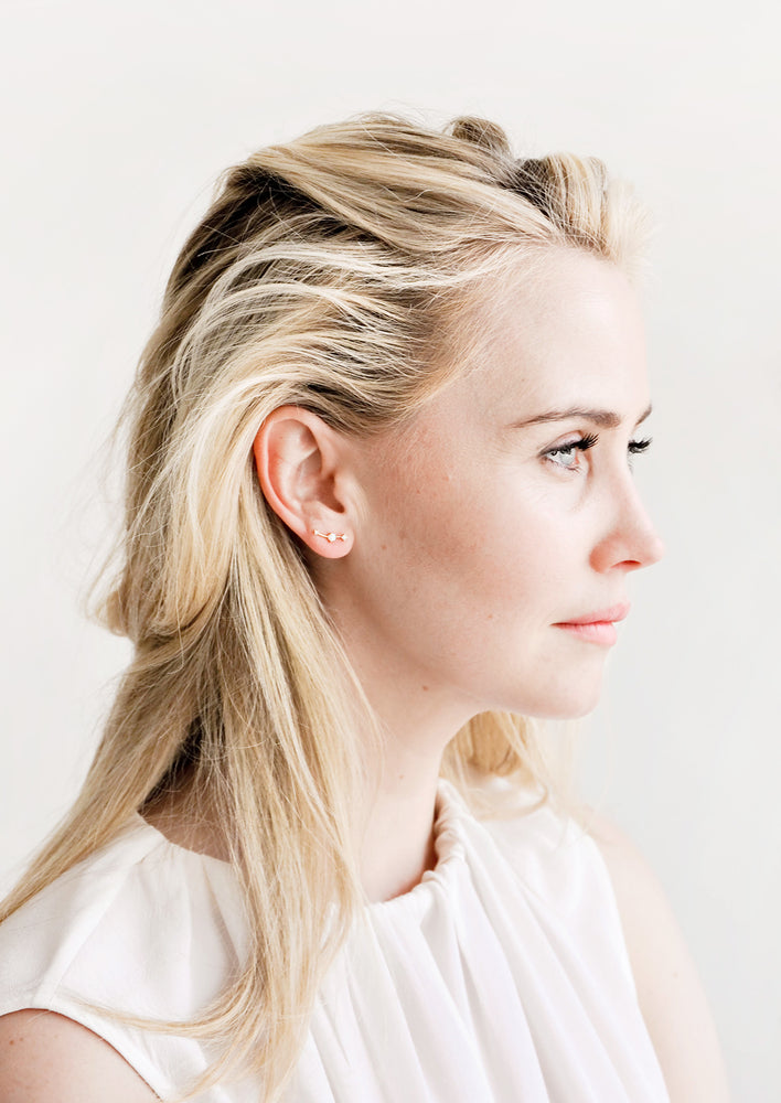 2: Model wearing opal and rhinestone climber-style stud earrings