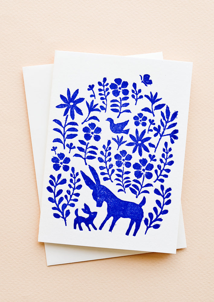 A white greeting card with blue otomi print on front and a plain white envelope.