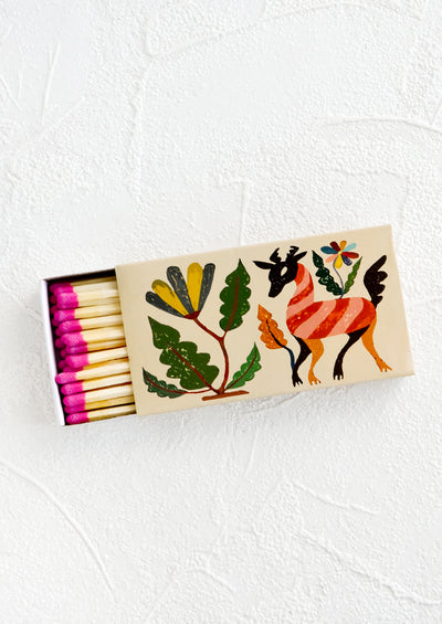 Matchbox printed with otomi textile inspired pattern, housing long matches with pink tips