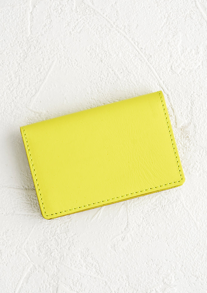 Neon Yellow: A small leather cardholder wallet in neon yellow.