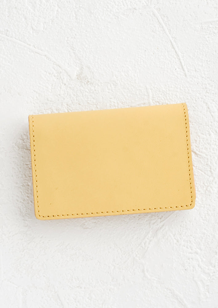Vanilla: A small leather cardholder wallet in vanilla.