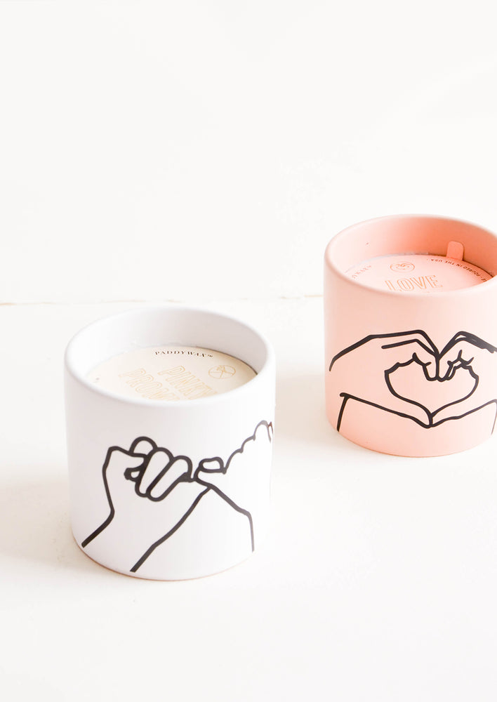 1: Scented candles in colored ceramic jar with hand symbol graphics
