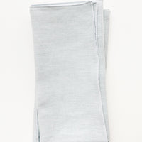 Mist: Pair of folded Linen Napkins in Misty Blue.
