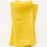 Turmeric: Pair of folded Linen Napkins in Yellow.