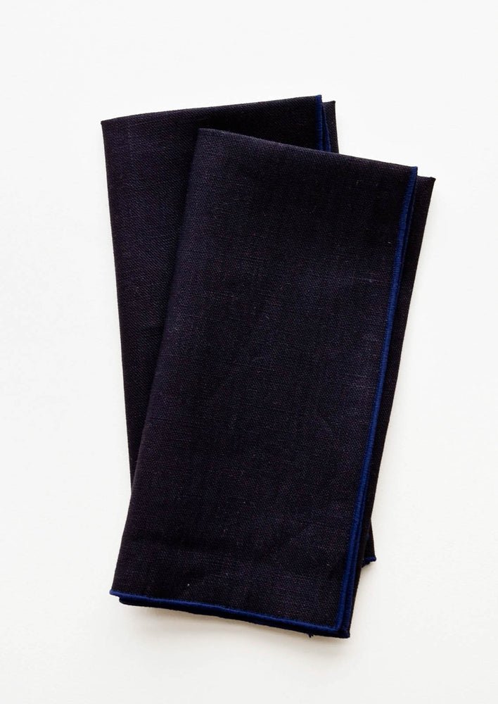 Ink Blue: Pair of folded Linen Napkins in Navy Blue.