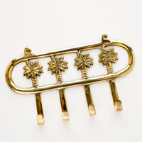 1: Wall mountable hook rack with 4 palm trees extending into hooks, made in brass