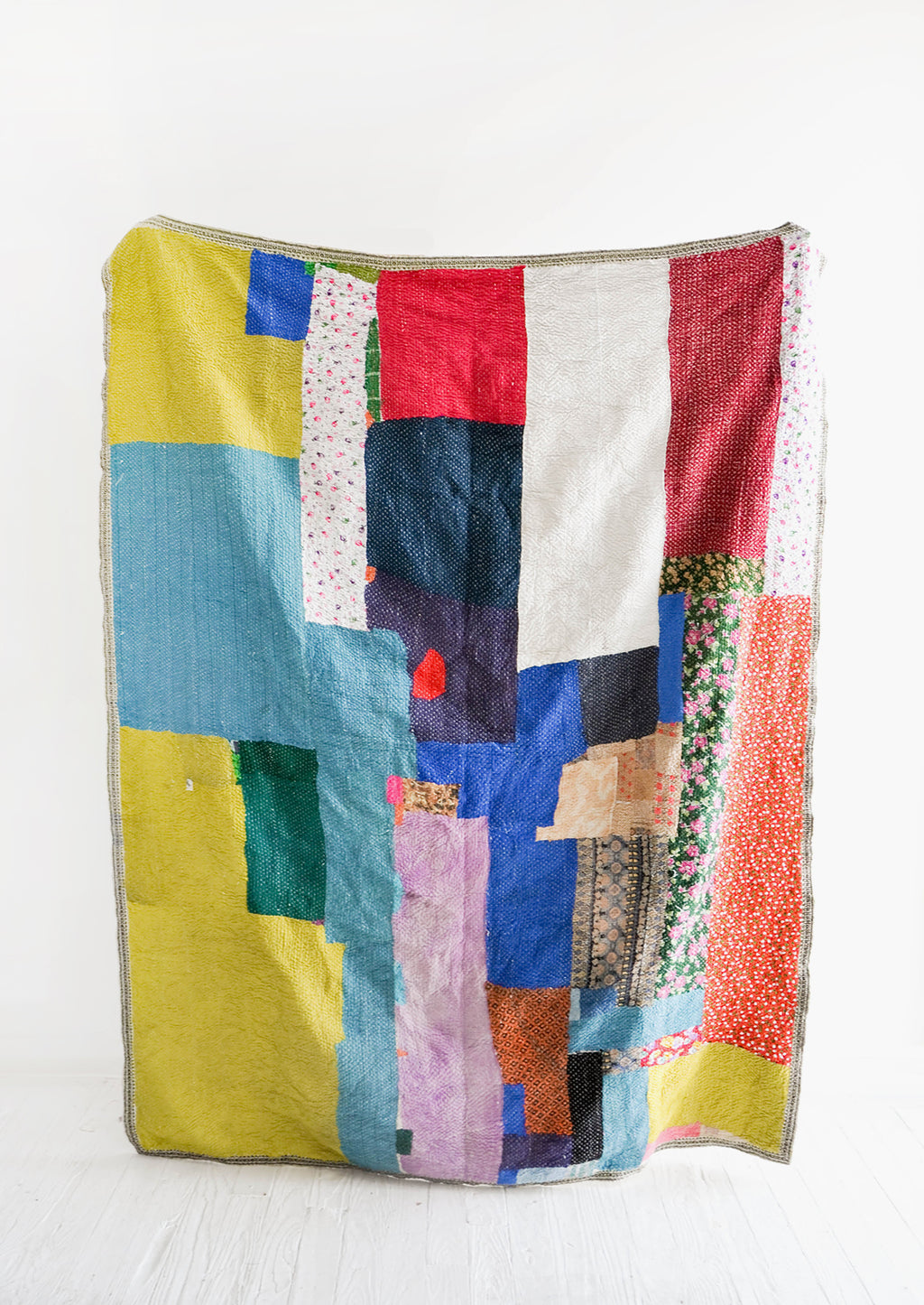 1: Vintage patchwork quilt in a colorful mix of fabrics. All different shades of green, blue, red & more.