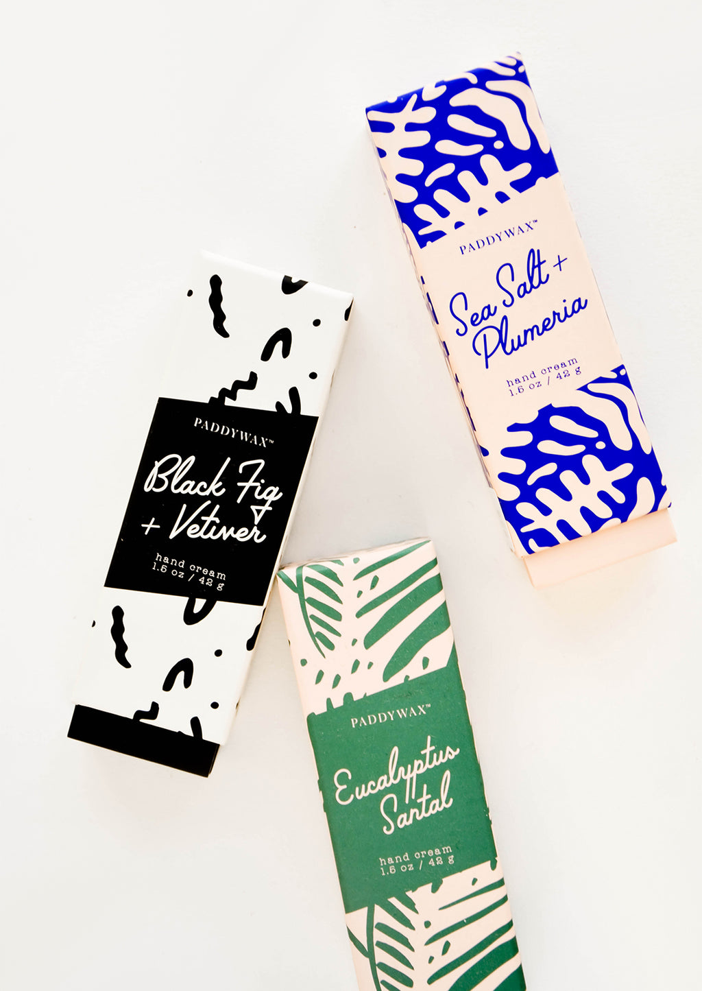 Eucalyptus Santal: Tubes of hand lotion in graphic print packaging