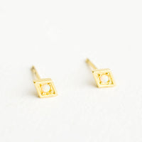 Diamond: Diamond shaped stud earrings in gold finish, with small round opal stone inset.