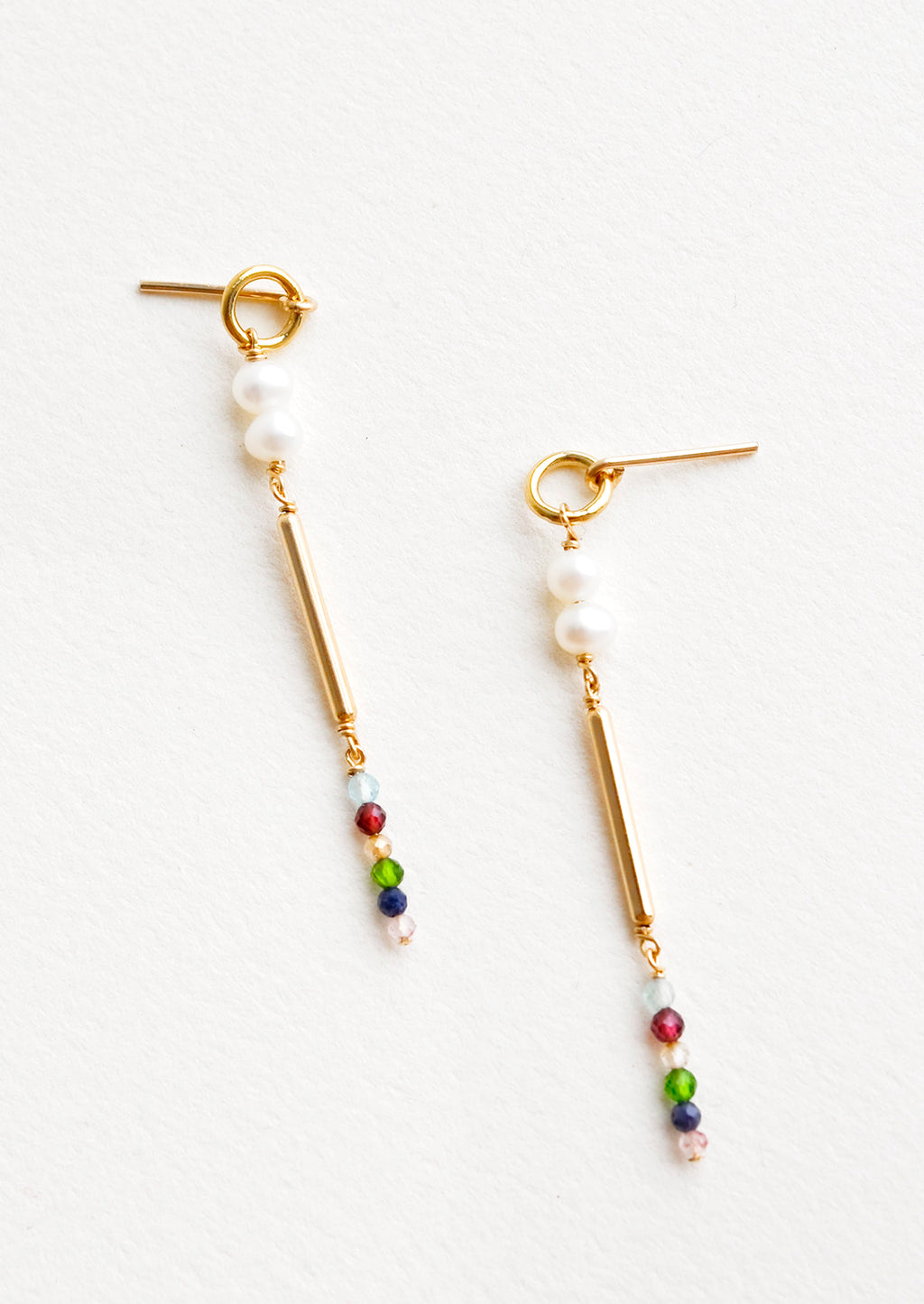 3: Dangling earrings featuring a small circle, two pearl beads, a gold post and six small multicolor gemstones on a yellow gold post back.