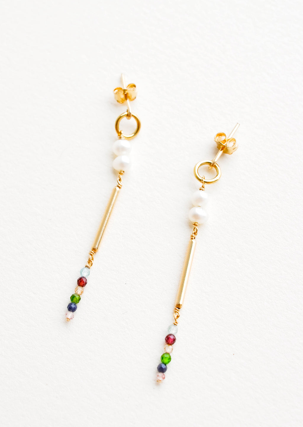 1: Dangling earrings featuring a small circle, two pearl beads, a gold post and six small multicolor gemstones on a yellow gold post back.
