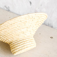 2: Woven raffia bowl with tapered top and round, footed base