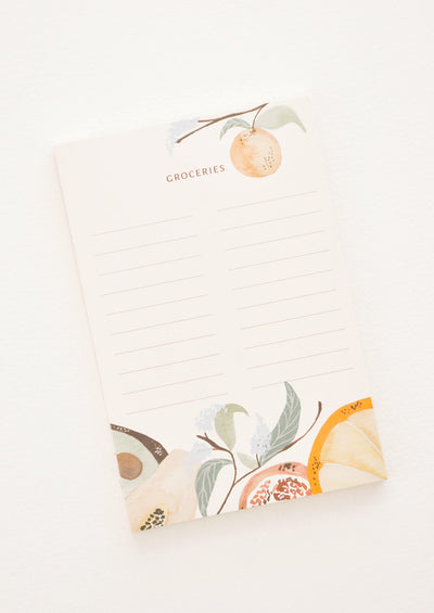 "Lined notepad featuring text ""Groceries"" and a fruit motif."