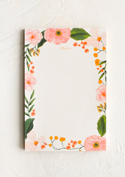 A notepad with floral border.