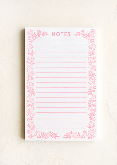 "A letterpress printed, lined notepad with peony border and ""NOTES"" printed at top."