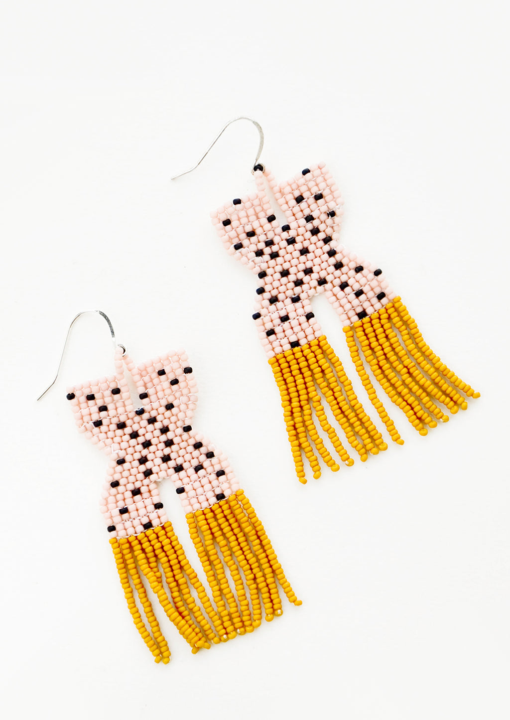 1: Pink x-shaped beaded earrings with black polka dots and mustard yellow fringe.