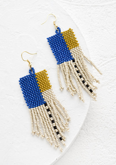 Beaded earrings with colorblock design and fringe.