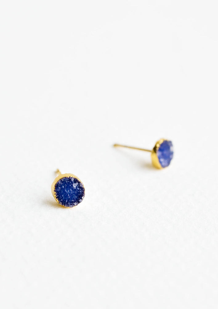 Textured blue gemstone studs with gold surround.