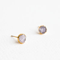 Mercury: Textured gray gemstone studs with gold surround.