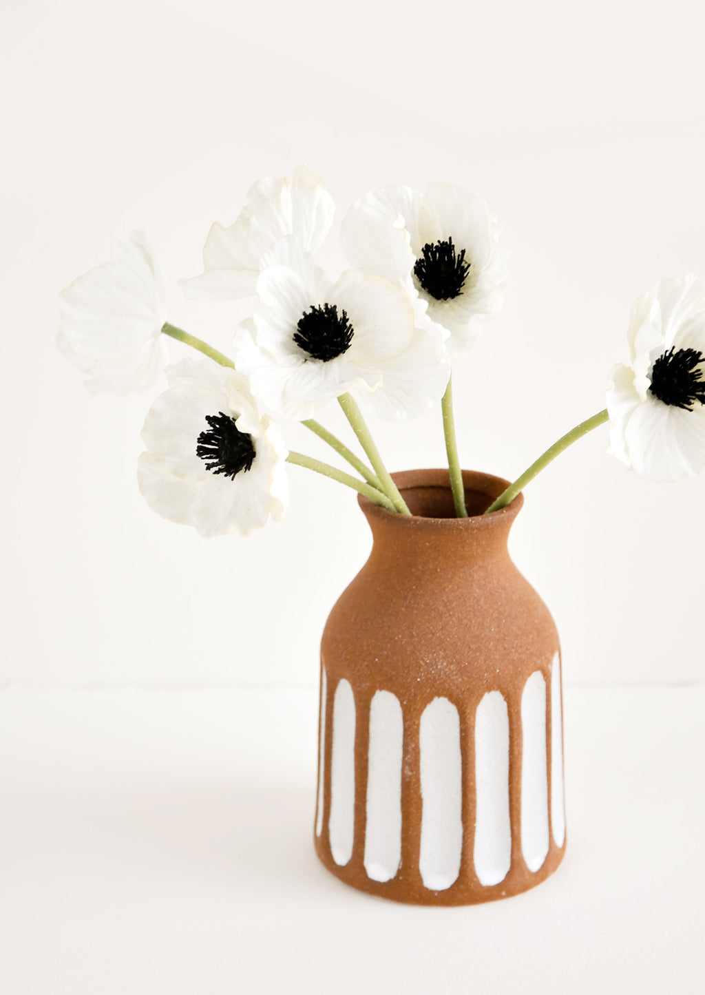 2: Brown Unglazed Ceramic Vase with Contrasting Vertical Stripe Detailing in White, displaying anemone flowers.