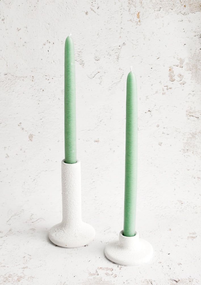 2: White ceramic taper candle holders in short and tall heights, displaying seafoam green taper candles