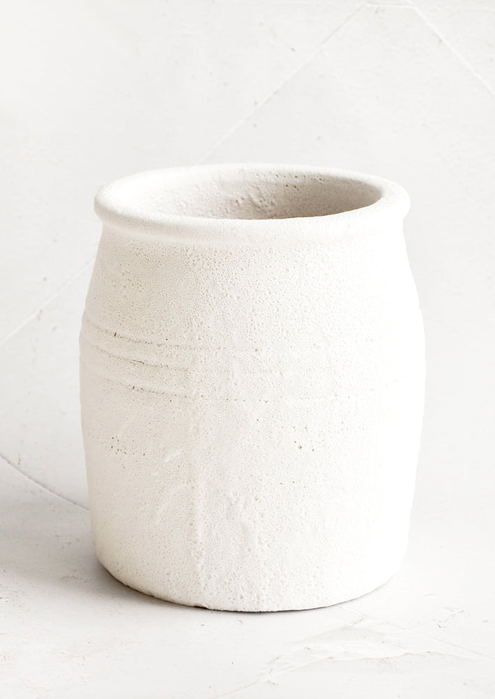 1: Crock-style utensil holder in ceramic with heavily textured, bubbly white glaze