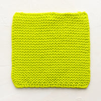 Lime: A square, chunky knit cotton potholder in lime green.