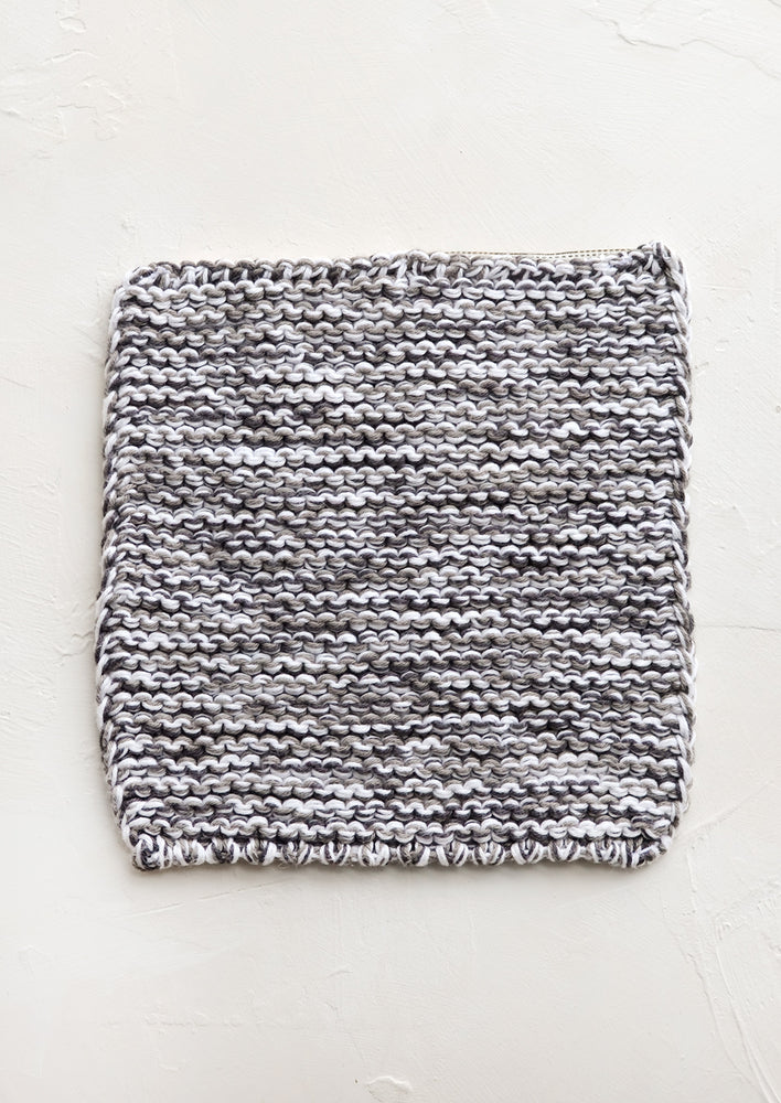 Grey Melange: A square, chunky knit cotton potholder in black and white marl.