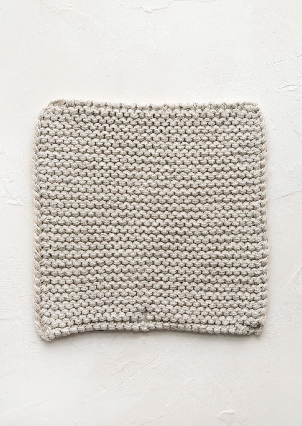 Oyster: A square, chunky knit cotton potholder in oyster grey.