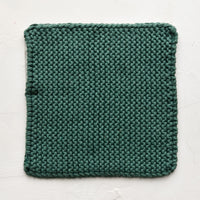 Spruce: A square, chunky knit cotton potholder in bottle green.