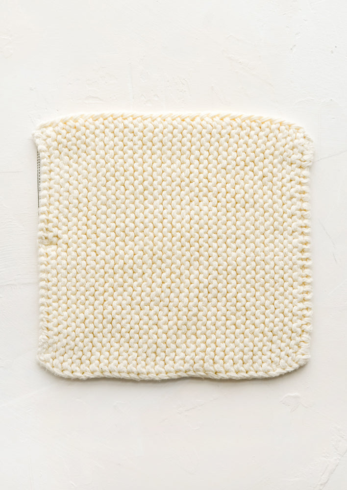 Vanilla: A square, chunky knit cotton potholder in off white.