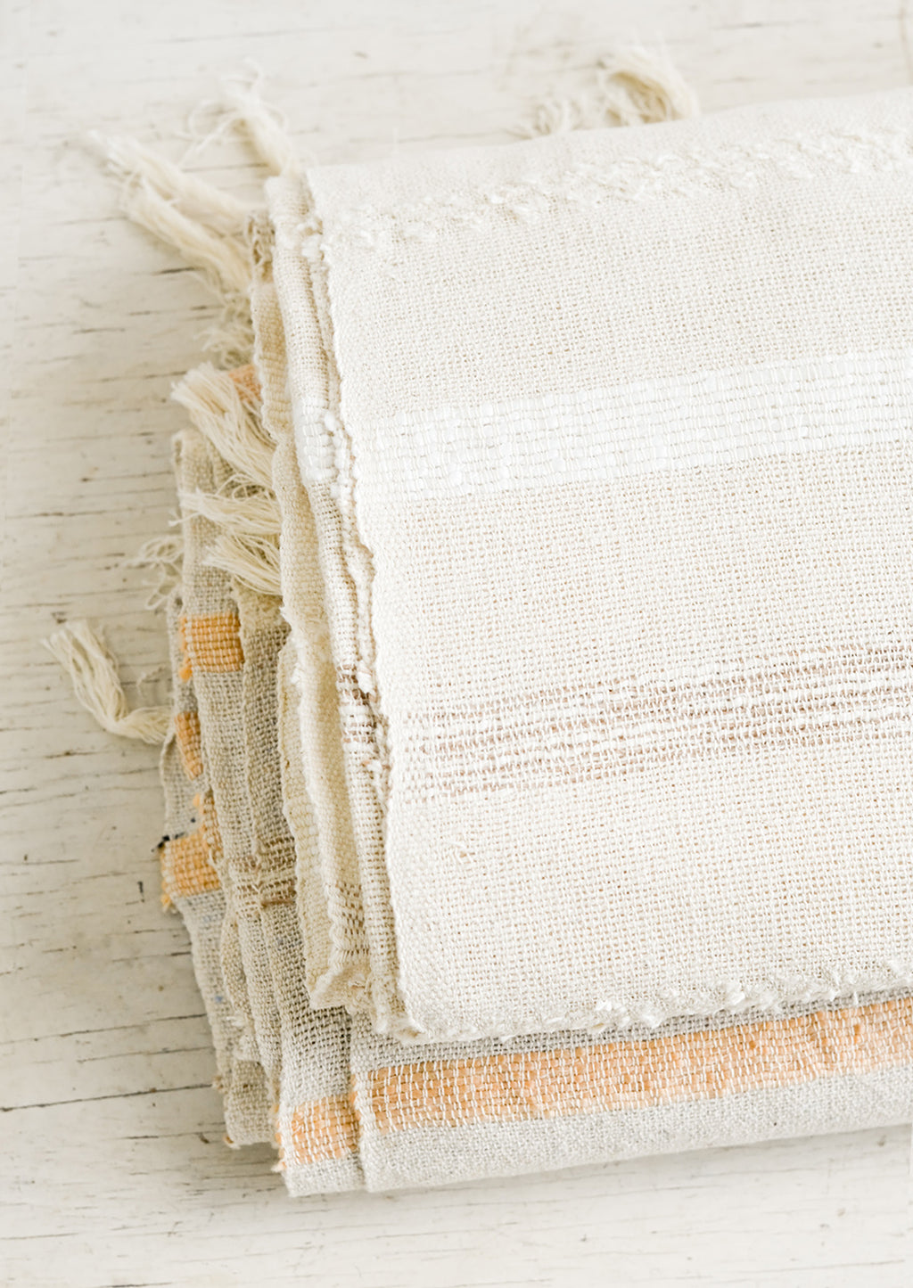 2: Folded gauze cotton blankets on a table.
