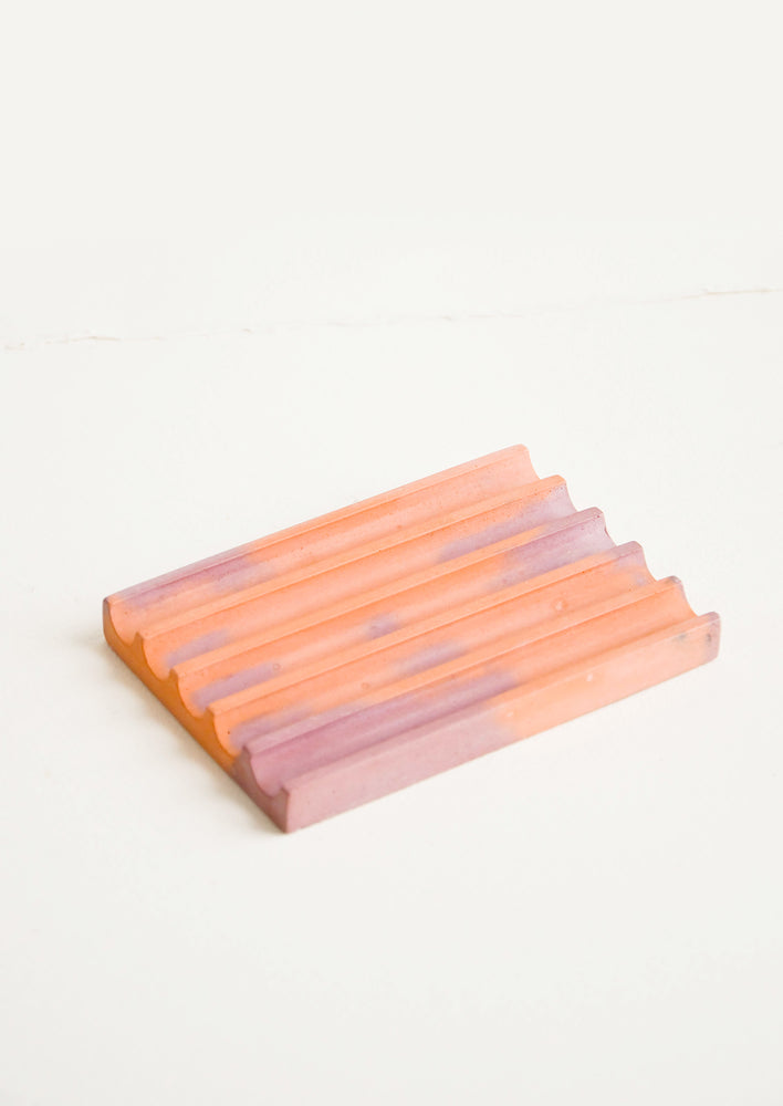 Coral / Mauve: A marbled coral and mauve smooth concrete soap dish with troughs and ridges.