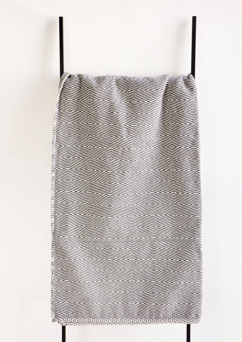 3: Blanket with Geometric Pattern in Black & White on Ladder - LEIF