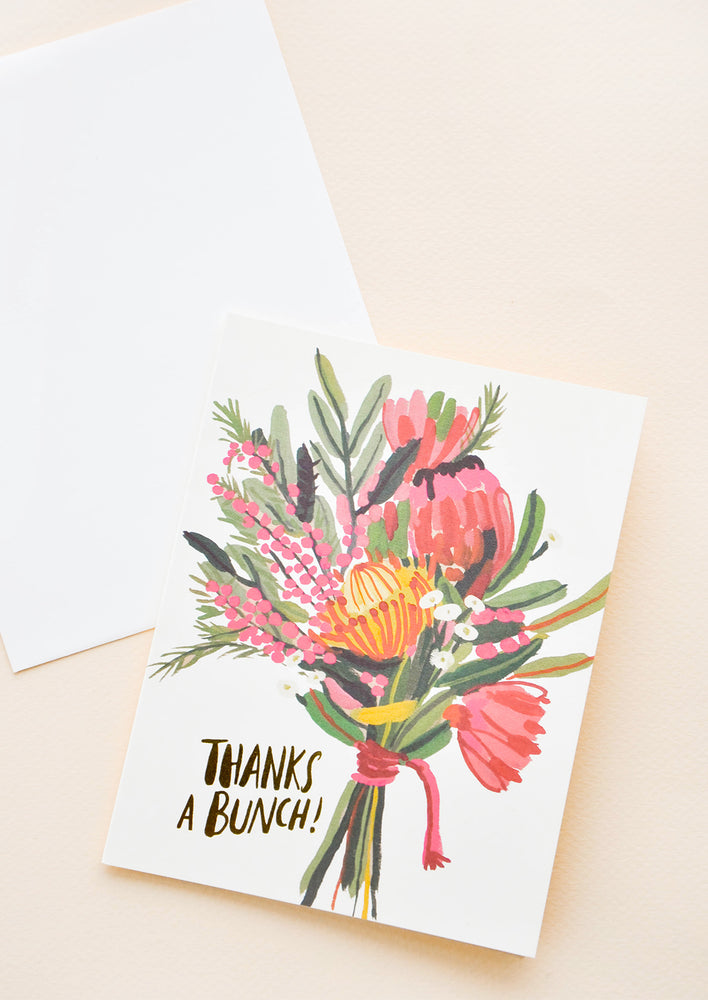"Greeting card with bouquet of flowers and ""Thanks a Bunch"" in gold text at corner"