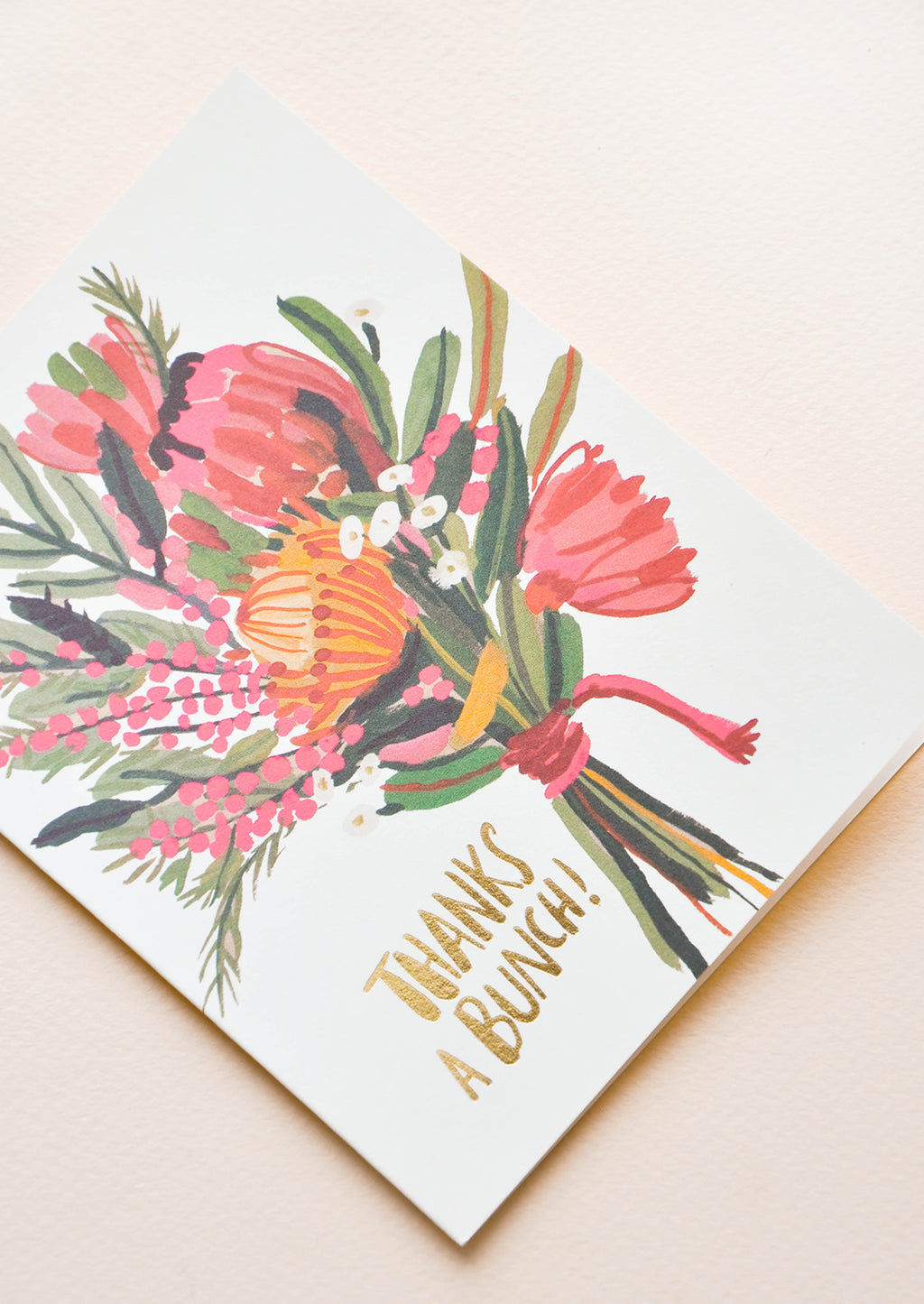 "2: Greeting card with bouquet of flowers and ""Thanks a Bunch"" in gold text at corner"