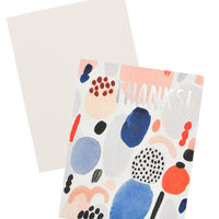 "2: Notecard with colorful abstract shapes and the text ""Thanks!"", with white envelope."