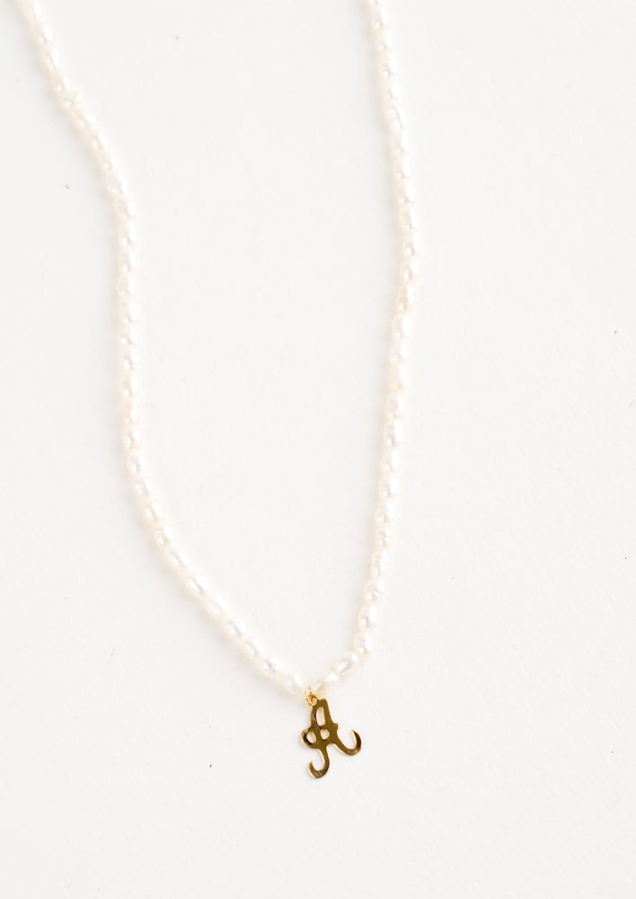A: Quincy Pearl Initial Necklace