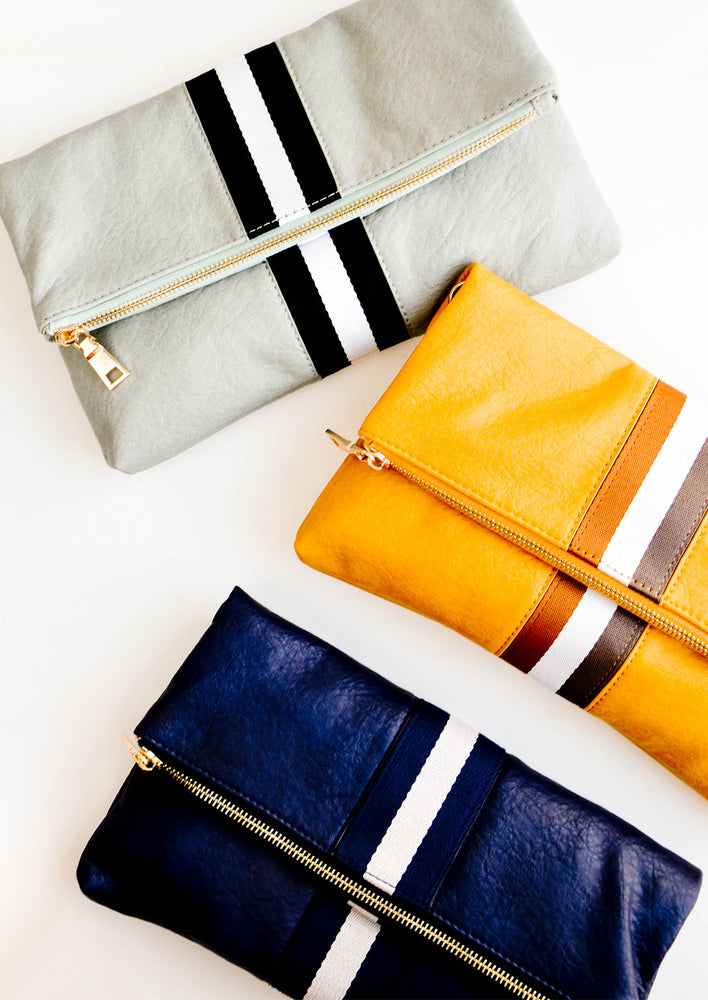 Navy / Ivory: One green, one yellow, and one navy clutch.