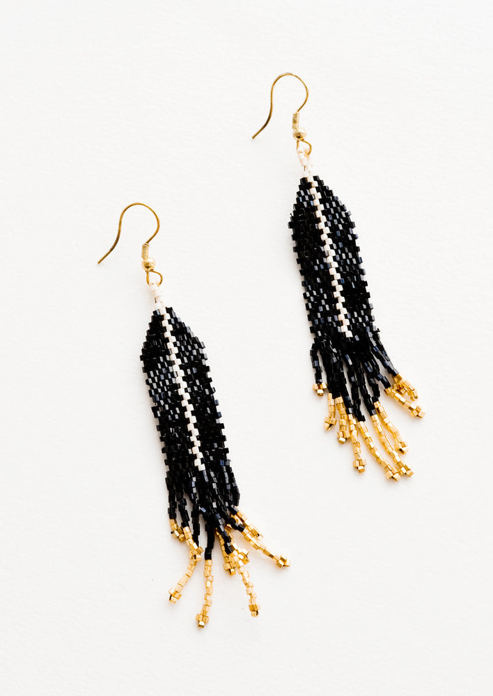 Black: Dangling beaded earrings with black beads accented with gold bead stripe and gold bead fringe.