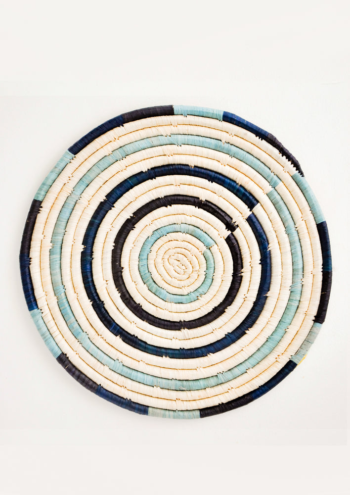 Blue Multi: Radiant Rays Raffia Trivet in Blue Multi - LEIF