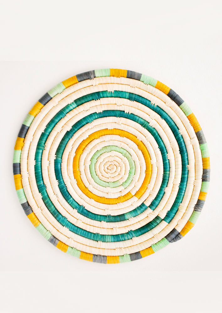 Emerald Multi: Radiant Rays Raffia Trivet in Emerald Multi - LEIF