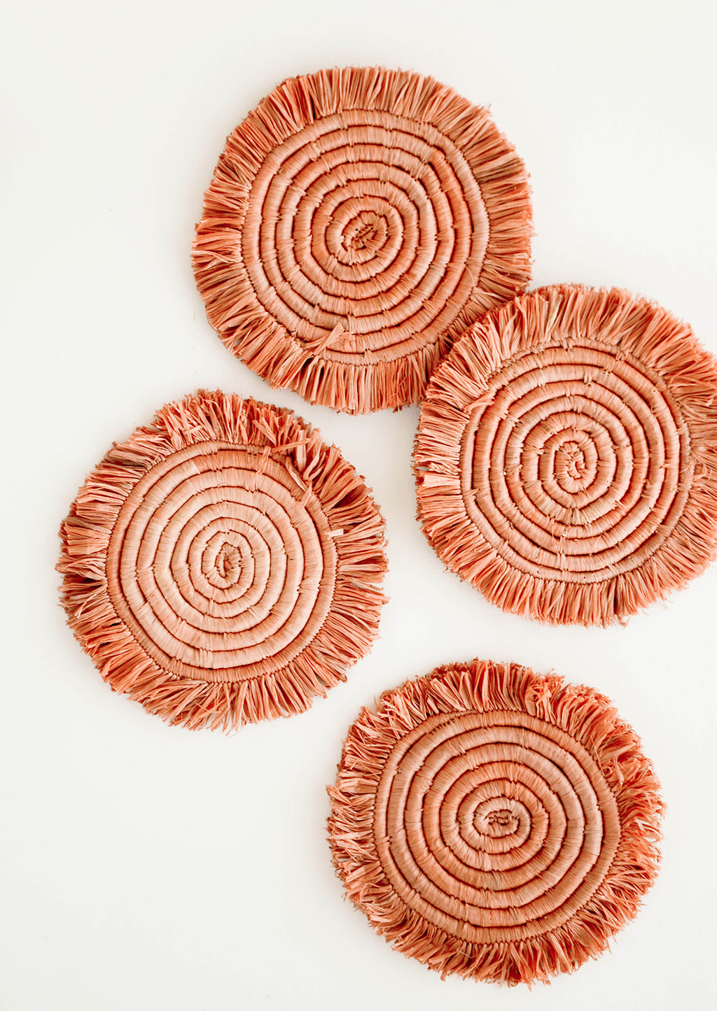 Terracotta Peach: Set of 4 Circular Raffia Coasters with Fringed Trim in Dark Peach