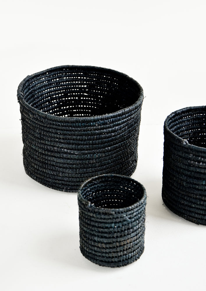 Extra Small / Black: Set of round catchall baskets made black raffia in three incremental sizes.