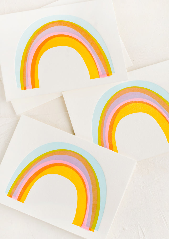 Boxed Set of 6: Three identical greeting cards with rainbows on front.