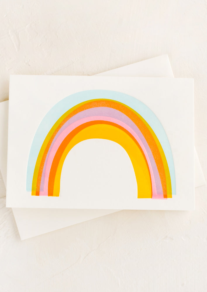 2: A greeting card with rainbow on front.