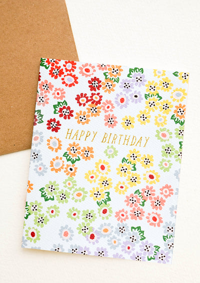 A floral print birthday card in rainbow colors.