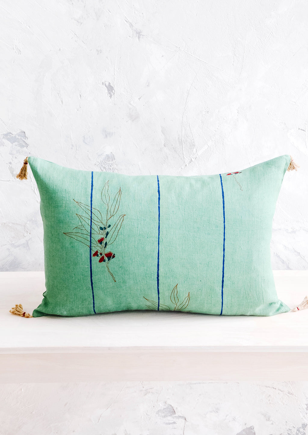 1: Decorative lumbar throw pillow in jade green linen with blue stripes and block printed floral detail