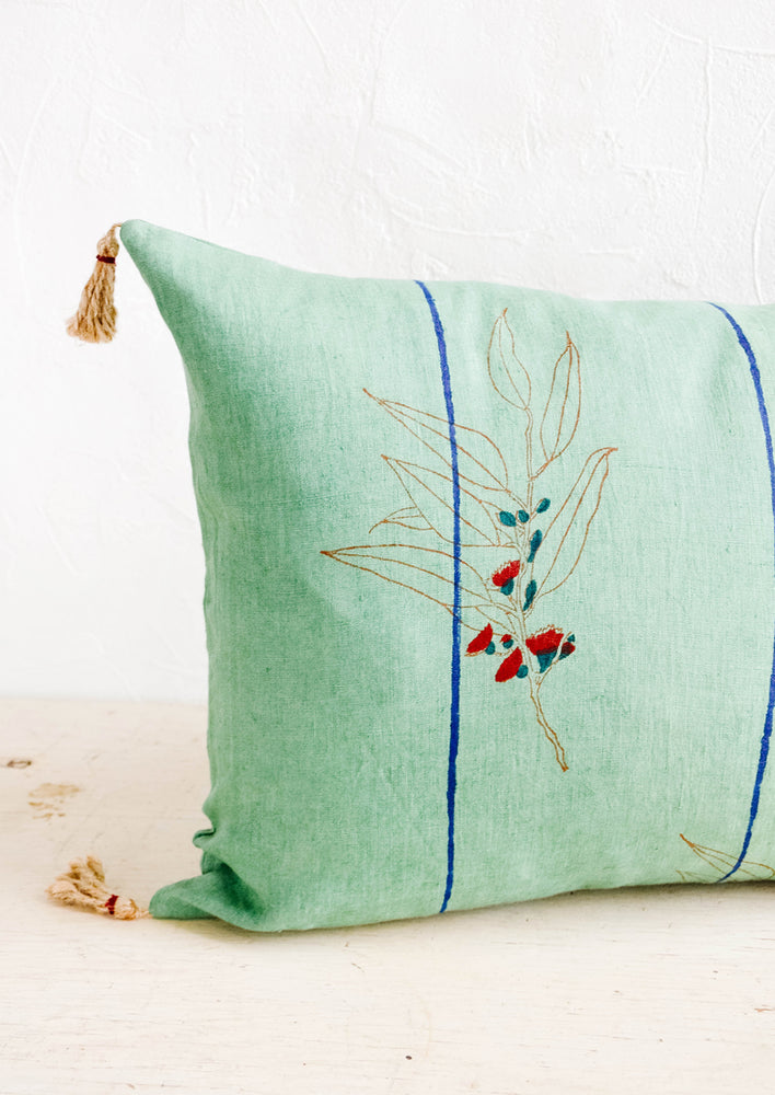 2: Decorative lumbar throw pillow with block printed floral and stripe print and jute tassels at corners