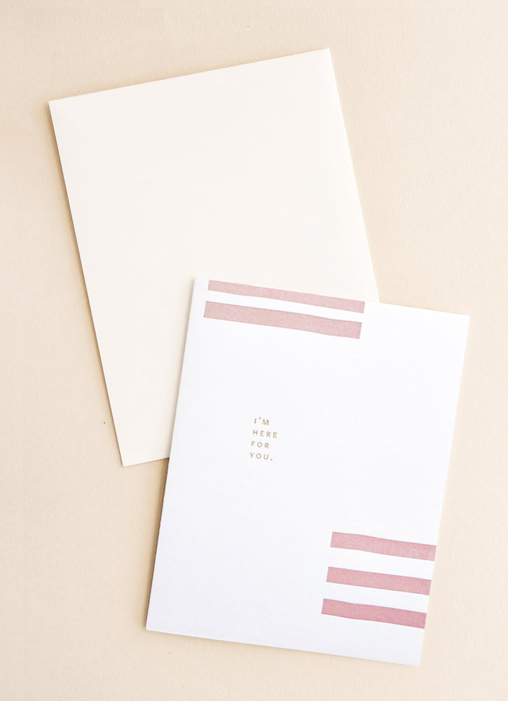 "1: White notecard with several parallel pink rectangles, and the text ""I'm here for you"", with cream envelope."